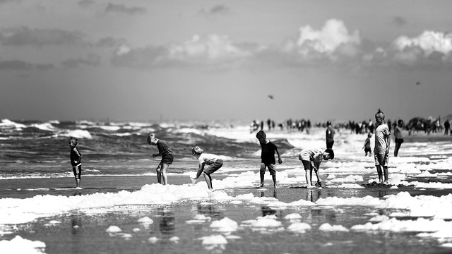 six young boys are playing at the beach of callantsoog - monochrome