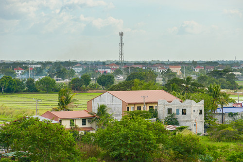 philippines landscapes southeast asia tropical country view rural suburban transition city homes residence buildings structures trees cell tower cellular horizon broad scenic