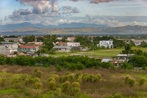 philippines landscapes southeast asia tropical country view rural suburban transition city homes residence buildings structures trees horizon broad scenic scenery wide angle