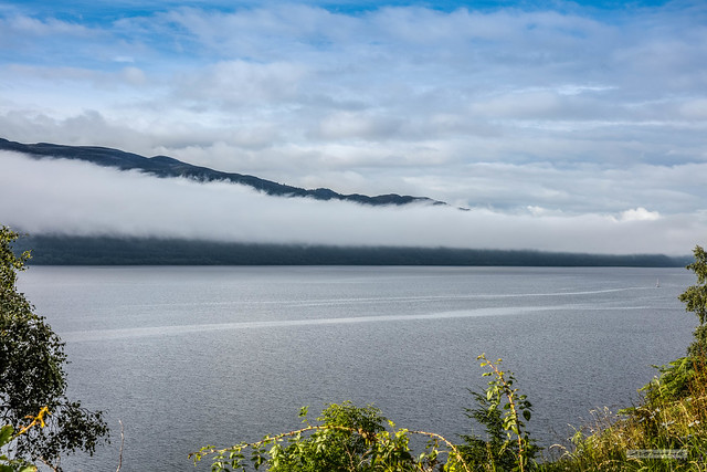 From opposite the village of Dores a ribbon of cloud lingers over the north-eastern end of Loch Ness.