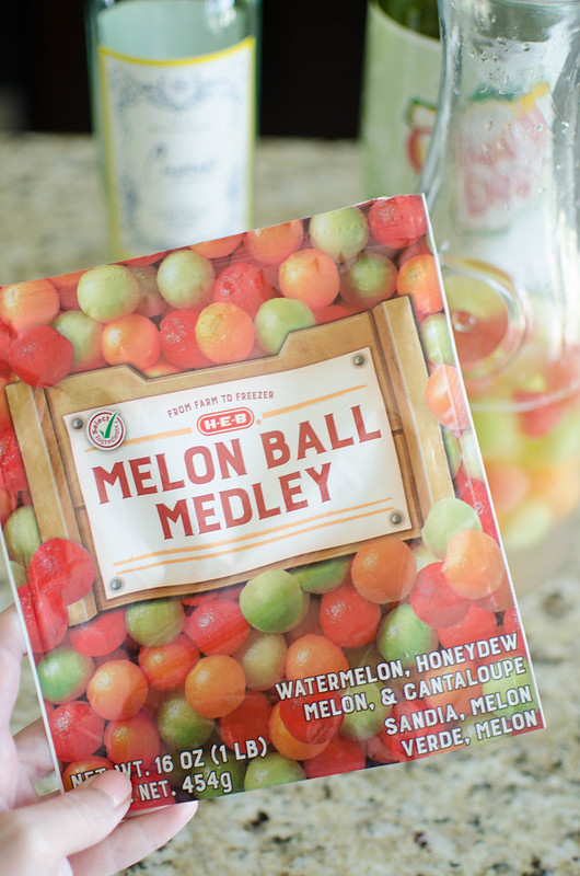 Melon Ball Sangria - the perfect summer cocktail! Watermelon, honeydew, and cantaloupe balls with fresh mint, white wine, vodka, and ginger ale. So refreshing, so simple, and great for a party!