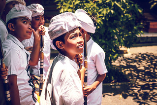 BALI, INDONESIA - OCTOBER 3, 2018: Balinese boys in traditional costume on a balinese family ceremony in desa Pejeng Kangi.