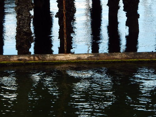 Water reflections of the pier at Stamp's Landing, Vancouver