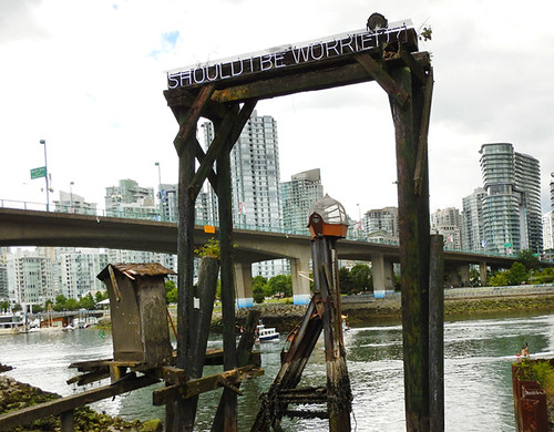 'Should I be worried?', an art piece framing a view of the city high-rises, on the seawall in south False Creek