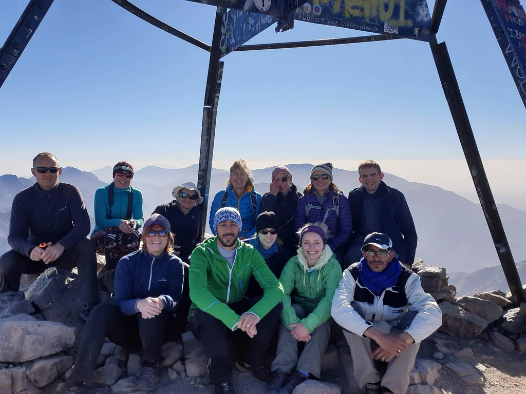 Jayne, Rob and I and the other Aztat Treks trekking group up at the summit of Mount Toubkal. Smiles all around! (And spot who forgot they were still wearing their head torch!!!)