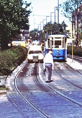 Mercedes ambulance and  tram wait for parade to finish Oktoberfest  Munich Sept 16 1978