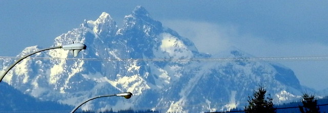 COASTAL MOUNTAINS AS SEEN FROM ABBOTSFORD,  BC.