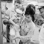 Saigon 1965 - Mother Carrying Child Injured in Vietnam Bombing