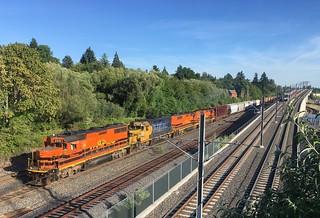 A P&W train races an interurban to the Springwater Trail bridge