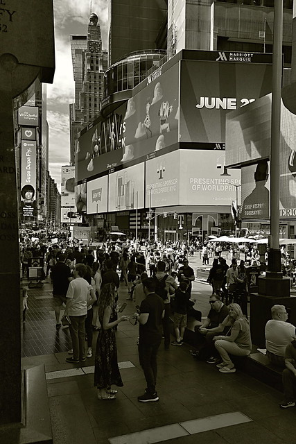 People in Duffy Sq/ Marriott Marquis Ad Screen