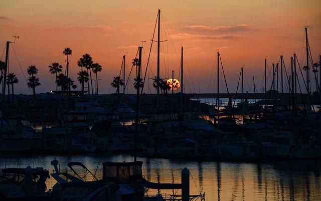 Setting sun over the harbor in Oceanside California