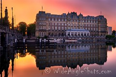 Amstel Hotel at Daybreak, Amsterdam #Amsterdam #BlueHour #reflections #reflection #longexposure #daybreak #sunrise #dawn #color #colorful #river #Amstel #boats #hotel #bridge #noperson #quiet #earlymorning