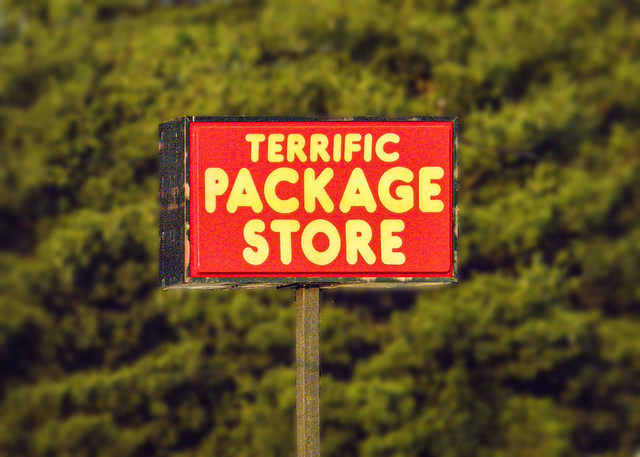 Sign / Package Store / Red / Green / Yellow / trees