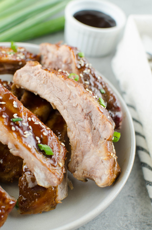 Hawaiian BBQ Ribs - oven baked ribs with a sweet and spicy Hawaiian-inspired sauce made with hoisin sauce, soy sauce, pineapple juice, fresh ginger, and sriracha. They are so tender and delicious!