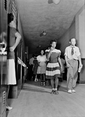 Hall Monitor: The corridor between classes at Central High School. A teacher watching to see that the students keep in order. Charlotte Court House, Virginia, June 1943