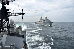 INDIAN OCEAN (June 14, 2019) The amphibious transport dock ship USS John P. Murtha (LPD 26) steams with the Indian Navy destroyer INS Ranvijay (D55) while training together in the Bay of Bengal. John P. Murtha is currently on its first deployment and part of the Boxer Amphibious Ready Group (ARG) and the 11th Marine Expeditionary Unit (MEU) team and is deployed to the 7th Fleet area of operations to support regional stability, reassure partners and allies, and maintain a presence postured to respond to any crisis ranging from humanitarian assistance to contingency operations. (Indian Navy photo)
