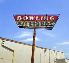Abandoned Bowling Alley and Sign