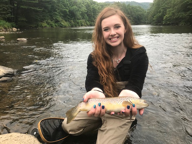Photo of  woman holding brown trout on the Youghiogheny River
