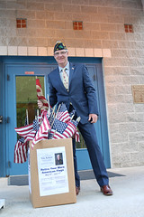 Rep. Ackert with the used and worn flag collection box at the Booth & Dimock Library in Coventry