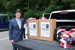 Rep. Ackert with used and worn flag collection boxes