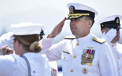 Rear Adm. Stuart P. Baker, commander of Carrier Strike Group (CSG) 9, returns the sideboys' salutes during a change of command ceremony aboard USS Theodore Roosevelt (CVN 71). (U.S. Navy/MC2 Pyoung K. Yi)