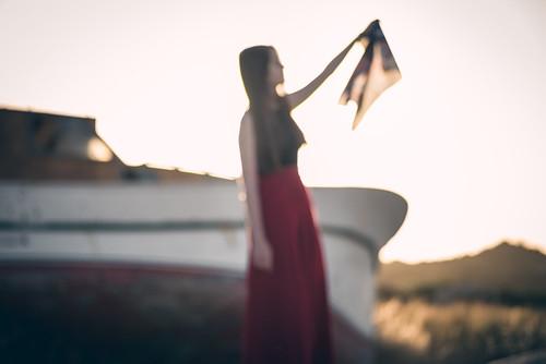 portrait art light sun summer red yellow people old new orange white outside sunset sky boat handkerchief remembrance samos blur bokeh girl