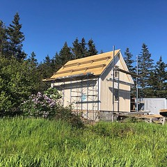 Marshall Point Lighthouse Barn update: the cedar roof is half done,the windows are mostly in and the siding is nearly complete.