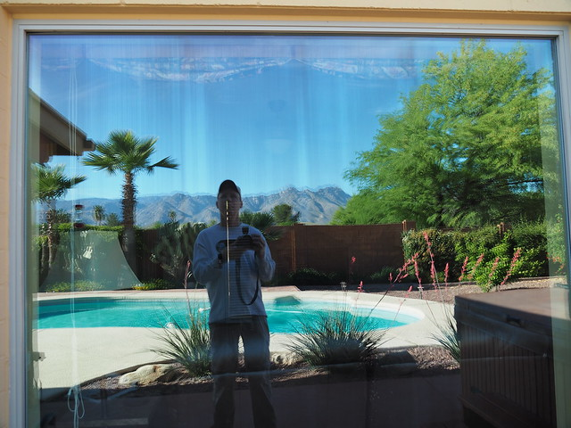 S4283469 Tucson rental house pool and tt reflect in window
