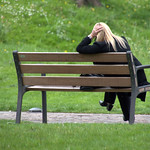 Woman on a bench at Winckley Square, Preston