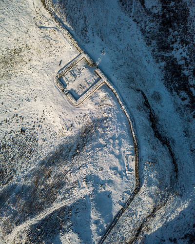 britain british england english greatbritain hadrianswall highshieldcrags milecastle39 northumberland oncebrewed romanbritain romanempire uk unitedkingdom aerialview birdseyeview countryside crag crags droneshot fort fromabove milecastle outdoors ruin ruins snow winter hexham