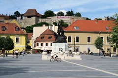 Eger main square, with Eger Castle and statue of Istvan Dobo