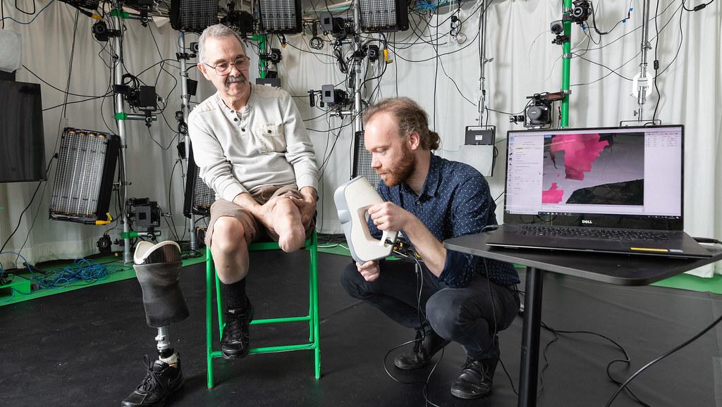 Matt Young takes a 3D scan of John's limb stump