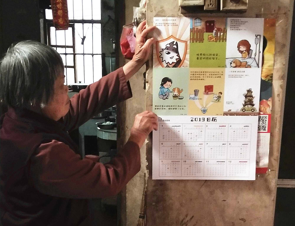 villager hangs calander on her wall