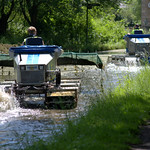 Water 'tractor' scooping the brown weed off the 200 year old canal at Preston