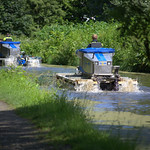Floating 'tractors' scooping the weeds at the Lancaster Canal in Preston