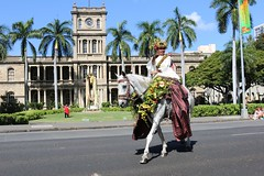 Hawaiian Electric at the 103rd annual King Kamehameha Floral Parade — June 8, 2019: The Pa'u queen greets the crowd in front of the King Kamehameha statue.
