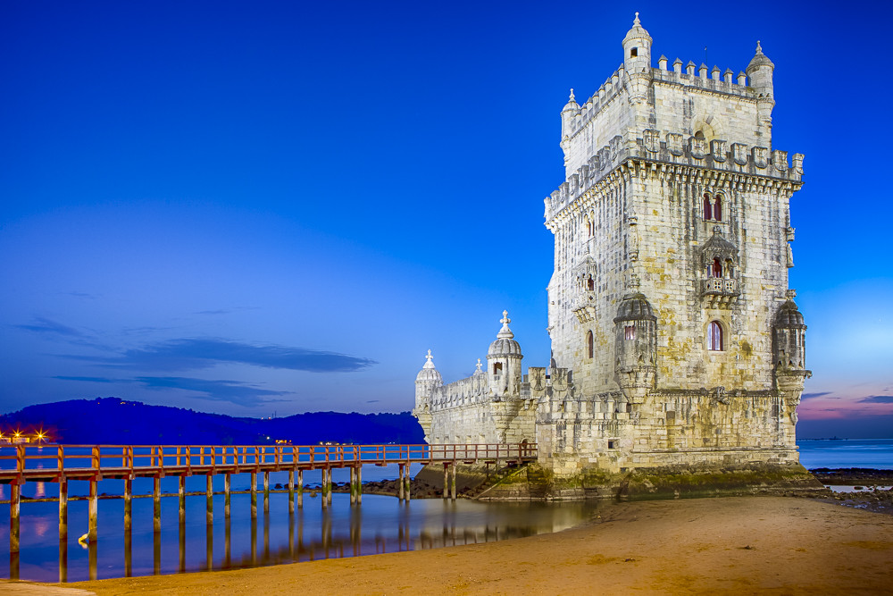 Famous Ancient Belem Tower on Tagus River in Lisbon at Blue Hour in Portugal.