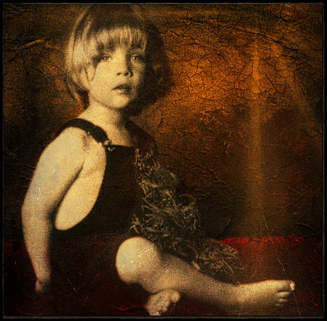 Young Blond Boy Sitting