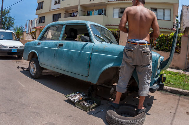 A Cuban Man Repairing a Car on the Street, Havana, Cuba