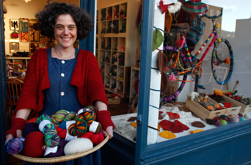 Anna Feldman outside Wild and Woolly local yarn store