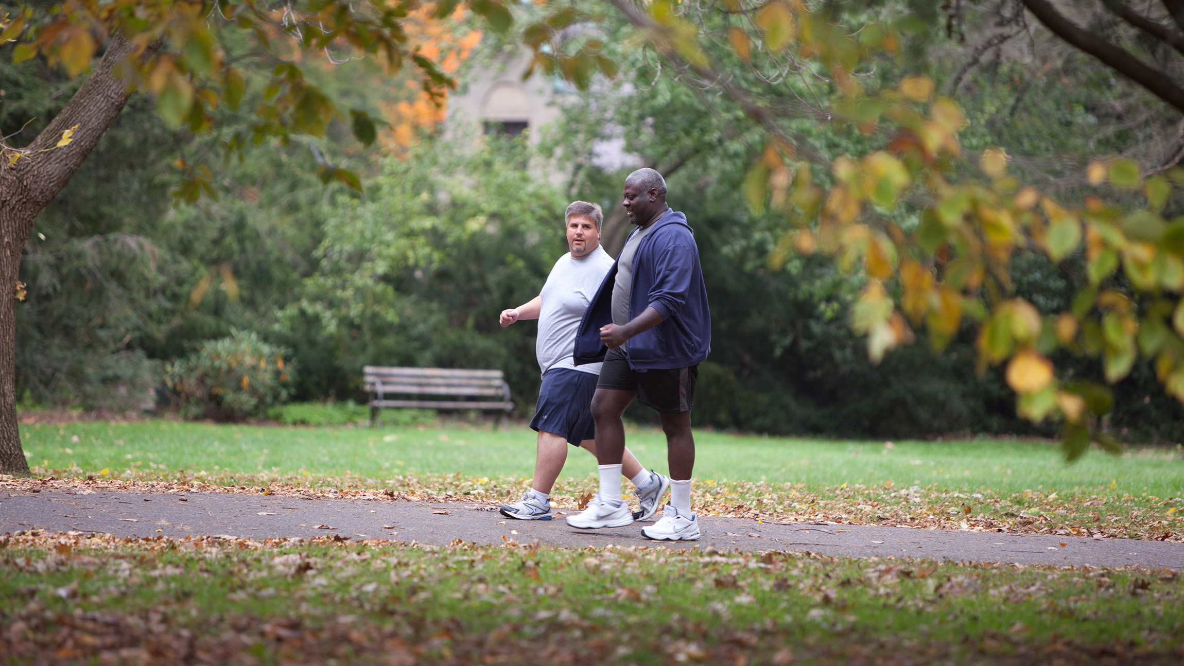 Two men walking in the park