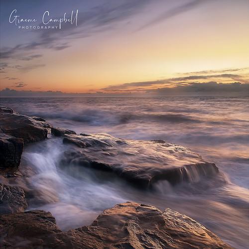 uk sunset northumberland sea rocks light ngc nikon d700