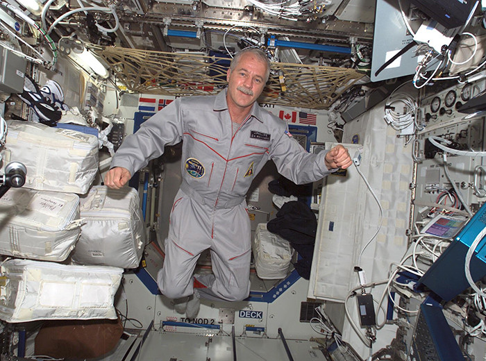 A man floats through a laboratory in the International Space Station.