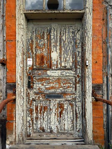 Peeling paint on the ancient door of a Tudor house in Copenhagen, Denmark