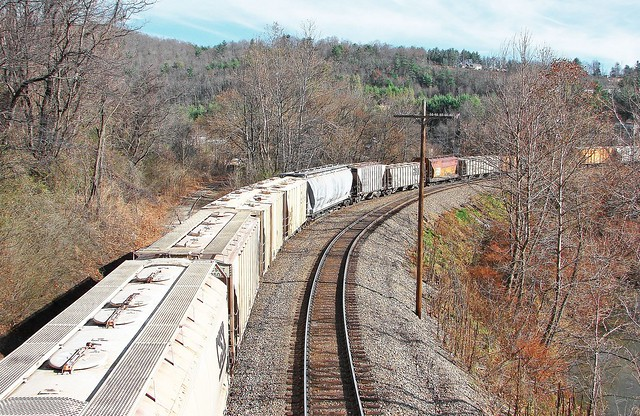 CSX has a long string of covered hopper cars spotted on a curved siding at Spruce Pine, North Carolina, 11-13-2006