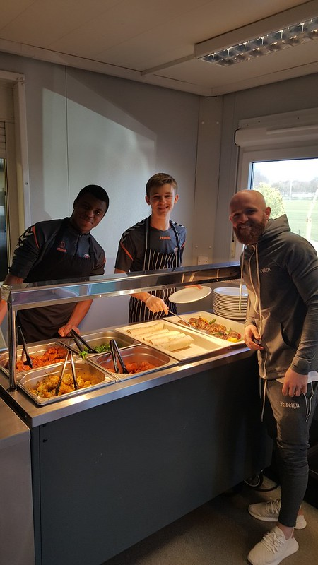 Serving food with Jonny Williams