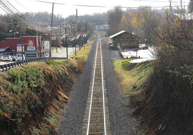 Norfolk Southern mainline line track passing through downtown area along side the restored and repurposed station in city of Marion, North Carolina, 11-13-2006