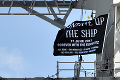 A commemorative flag flies aboard USS Fitzgerald (DDG 62) after being unveiled during a remembrance ceremony, June 17. (U.S. Navy/Samantha Crane)