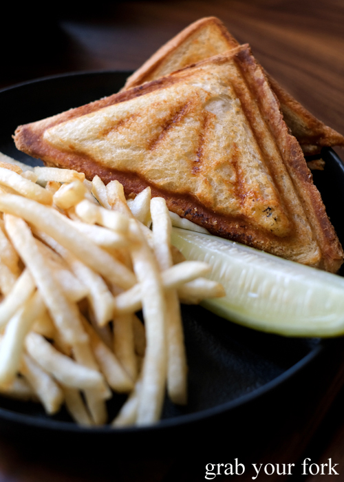 Gruyere de comte jaffle with fries and pickle at Esquire Drink and Dine in the QVB, Sydney