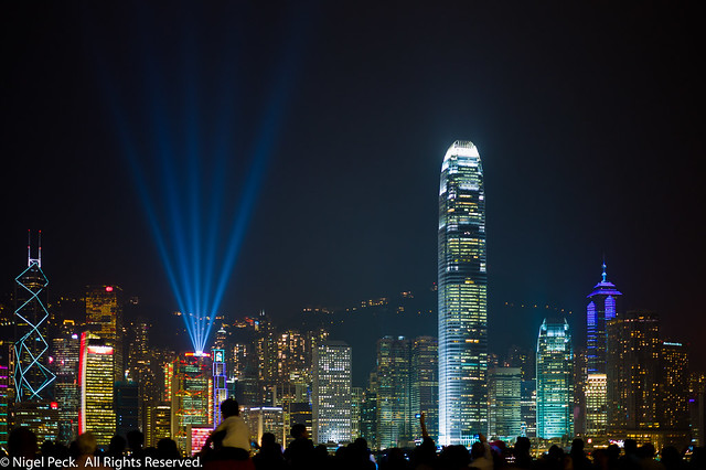 People enjoying LASER Light Show, Nightly at 8, Hong Kong Harbour